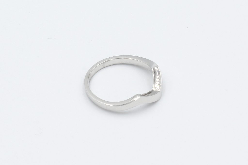 top view of a shaped white gold wedding ring